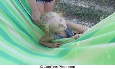 Girl in hammock - Little girl with hammock.