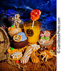 Halloween table with trick or treat dacoration. Holiday...