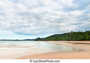 People walking along Ao Nang beach Krabi - Walking along the...