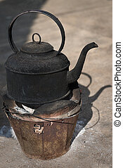 Blackened Kettle on a Fire Pot - Old kettle, blackened with...