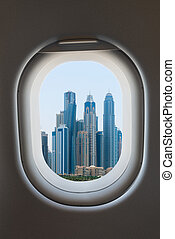 Airplane window from interior of aircraft. - Airplane window...
