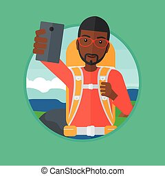 Tourist with backpack making selfie. - An african-american...