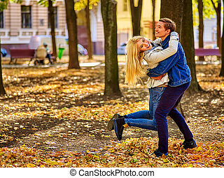 Young couple active rest in open air in autumn park. - Young...
