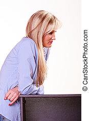 Middle age woman sit at table side view - Relax free time...
