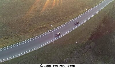 Aerial shot of highway junction, drone follow the car