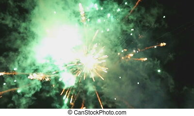Bright many-coloured fireworks against black sky