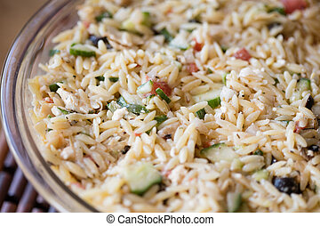 Mediterranean Orzo Salad - Closeup of a bowl of...
