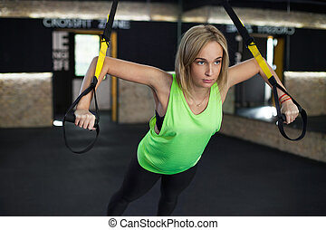 Women doing training with trx - Women doing push ups...