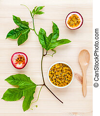 Fresh passion fruits set up on wooden background Juicy...