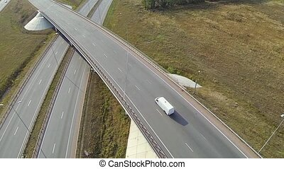 Aerial shot of highway junction, drone follow the car.