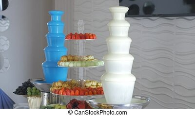 Dessert table with chocolate machine fountain.
