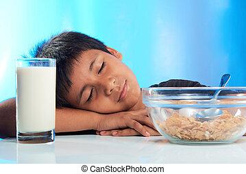 boy sleep on breakfast table