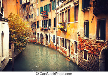 Narrow canal in Venice at autumn
