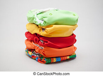 Stack of cloth diapers different colors - Stack of eco cloth...
