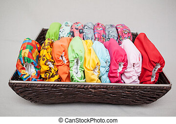 Cloth diapers in the basket - A lot of eco cloth diapers in...