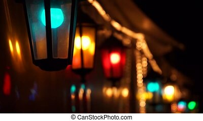 Colorful street lights swaying in the wind