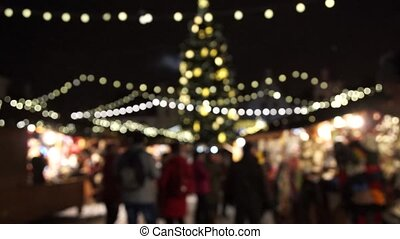 People visit Christmas Fair in old town at evening in Riga,...