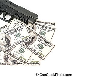 Close up image of pistol and dollar . - Close up image of...