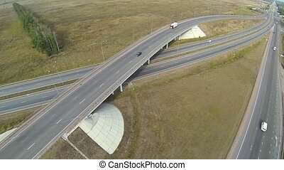 Aerial shot of highway junction, drone follow the truck.