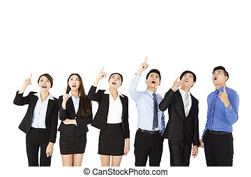 surprised and amazed business people looking and pointing up