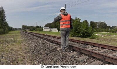 Railroad worker walking near railway