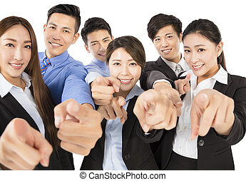 Young  Business team with pointing to camera gesture