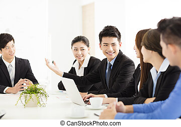 Group of happy young business people in  meeting