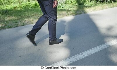 Man in suit walking on the road slowmo