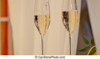Champagne glasses on celebratory table.