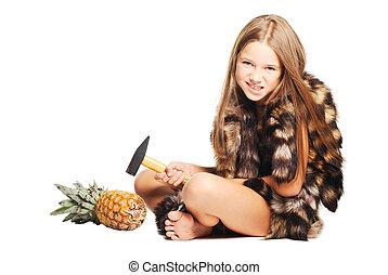 Little girl dressed in furs like prehistoric man