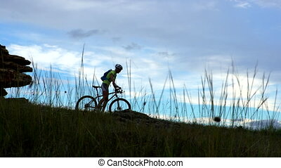woman riding mountain bike outdoor in the country -...
