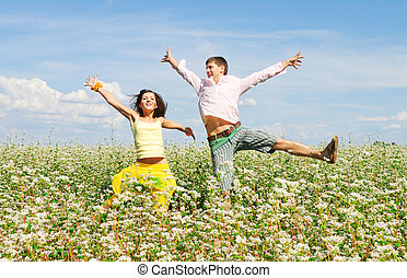 Happy couple on a summer lawn
