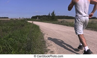 Young athlete running away on rural
