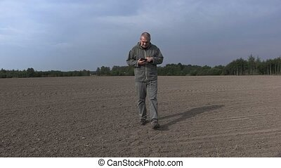 Farmer on the field check the soil