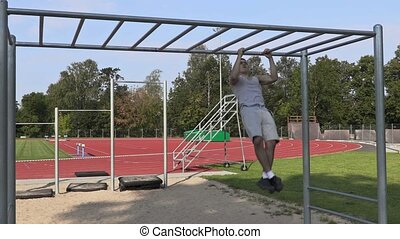 Young athlete training on gymnastic bars