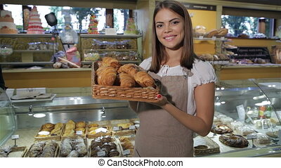 Woman keeps the box with croissants - Attractive caucasian...