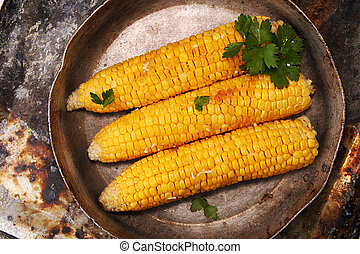 Corn baked in oven with butter and garlic - in old pan....