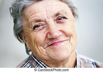Happy granny face on a gray