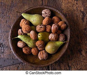 Antique bowl with pears and walnuts - Fall still life with a...