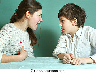 siblings boy and girl arguin close up photo