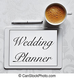 text wedding planner in a tablet computer - high-angle shot...
