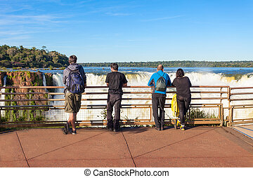 The Iguazu Falls - Tourists near the Iguazu Falls,...