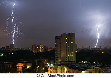 two lightning in night sky in the city