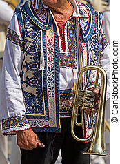 Detail of traditional Romanian folk costume worn by men from...