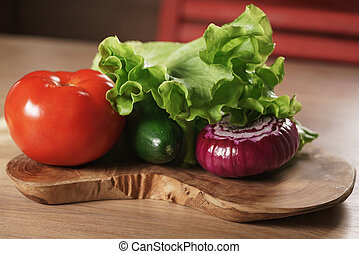 raw vegetables on kitchen table, ingredients for burger