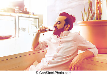 smiling man with beard and hair bun at office - business,...