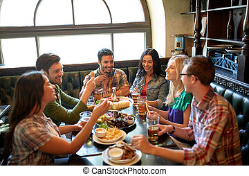friends dining and drinking beer at restaurant - leisure,...