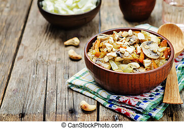 Cashew cabbage with mushrooms. toning. selective focus