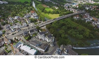 River and highway crossing dutch town, aerial view. Traffic...