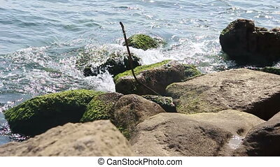 Ocean waves crash over a rocky shore. Caspian Sea